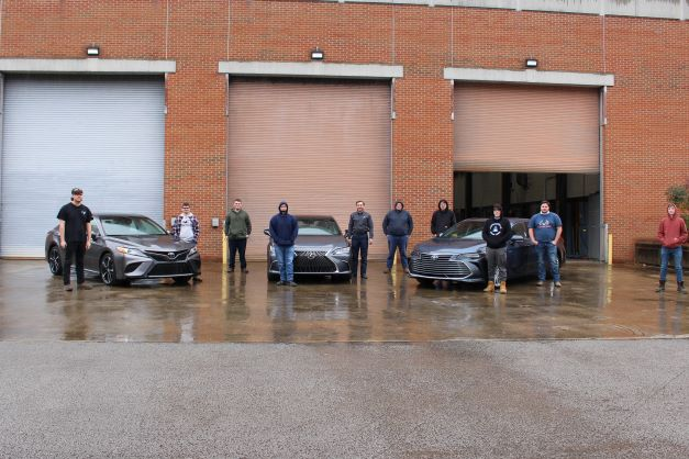Southeast automotive technology students from Harlan County High School pose with the Camry, Lexus, and Avalon recently gifted by Toyota Manufacturing of Kentucky.